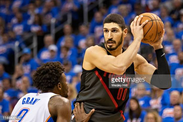 Enes Kanter of the Portland Trail Blazers with the ball while being defended by Jerami Grant of the Oklahoma City Thunder during Round One Game Three...
