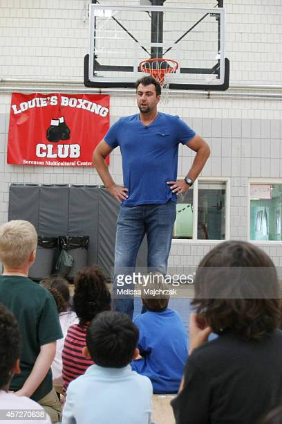 Enes Kanter of the Utah Jazz and former Jazz player Mehmet Okur visit Sorenson Multicultural Center to hand out tickets to the Jazz season opener...