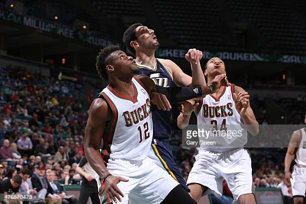 Enes Kanter of the Utah Jazz battles for position against Jeff Adrien and Giannis Antetokounmpo of the Milwaukee Bucks on March 3 2014 at the BMO...