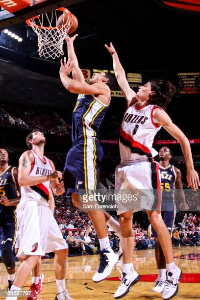 Enes Kanter of the Utah Jazz goes to the basket against Adam Morrison of the Portland Trail Blazers during a preseason game on October 22 2012 at the...