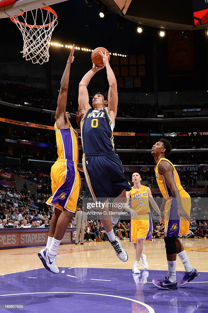 Enes Kanter #0 of the Utah Jazz goes up for a dunk against the Los Angeles Lakers at Staples Center on October 22, 2013 in Los Angeles, California.