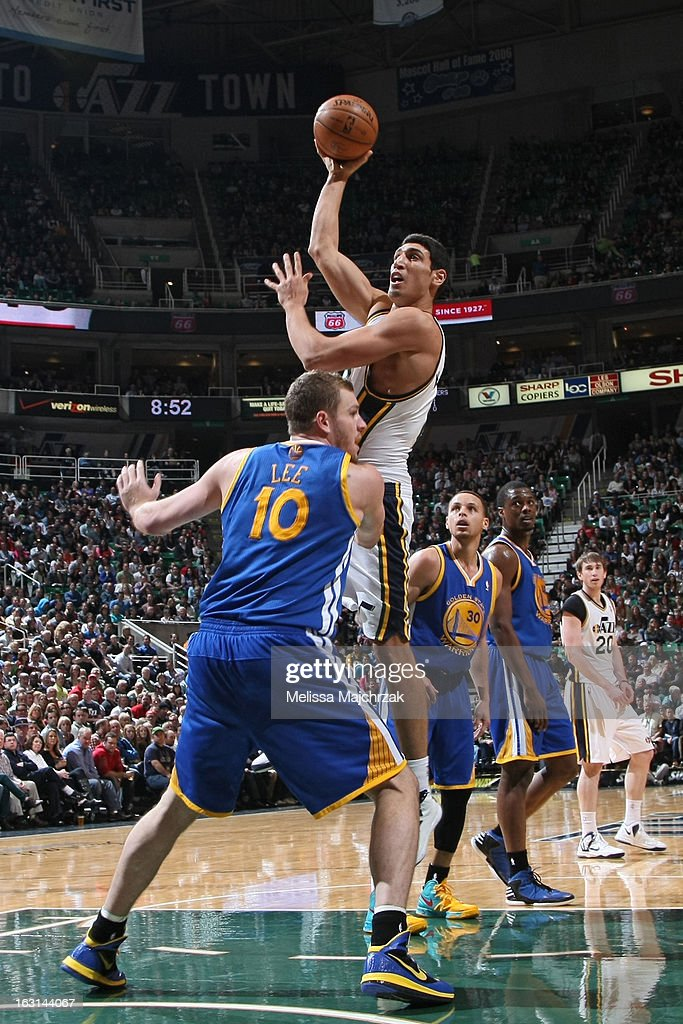 Enes Kanter #0 of the Utah Jazz puts up a shot against the Golden State Warriors at Energy Solutions Arena on February 19, 2013 in Salt Lake City, Utah.
