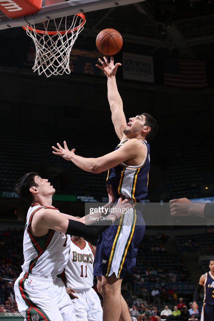 Enes Kanter #0 of the Utah Jazz shoots against Ersan Ilyasova #7 of the Milwaukee Bucks on March 3, 2014 at the BMO Harris Bradley Center in Milwaukee, Wisconsin.