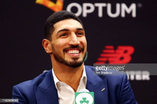 Enes Kanter reacts during a press conference as he is introduced as a member of the Boston Celtics at the Auerbach Center at New Balance World...