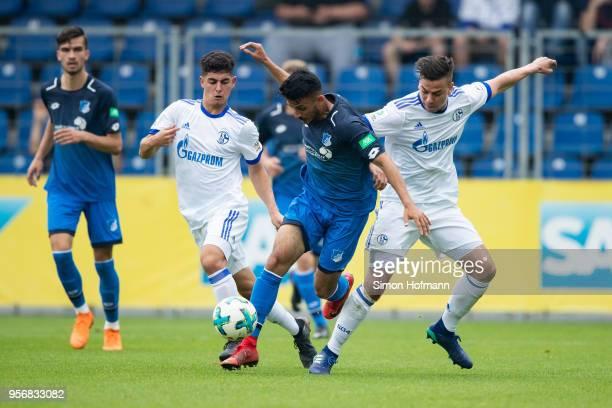 Enes Olgun Tubluk of Hoffenheim is challenged by Andriko Smolinski of Schalke during the German A Juniors Championship Semi Final Leg One match...