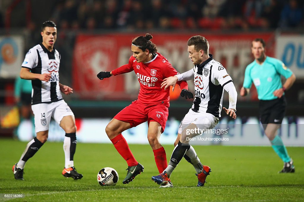 Enes Unal of FC Twente battles for the ball with Mike te Wierik of Heracles Almelo during the Dutch Eredivisie match between FC Twente and Heracles Almelo held at De Grolsch Veste on January 20, 2017 in Enschede, Netherlands.