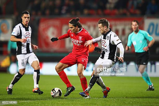 Enes Unal of FC Twente battles for the ball with Mike te Wierik of Heracles Almelo during the Dutch Eredivisie match between FC Twente and Heracles...