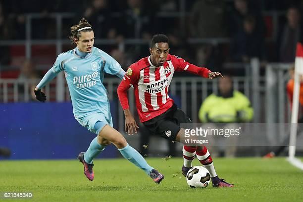 Enes Unal of FC Twente Joshua Brenet of PSVduring the Dutch Eredivisie match between PSV Eindhoven and FC Twente at the Phillips stadium on November...