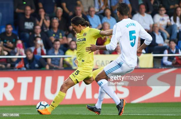 Enes Unal of Villarreal CF and Raphael Varane of Real Madrid during the La Liga match between Villarreal CF and Real Madrid at La Ceramica Stadium on...