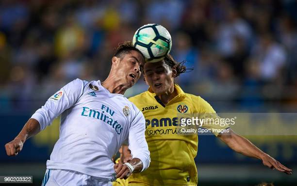 Enes Unal of Villarreal competes for the ball with Cristiano Ronaldo of Real Madrid during the La Liga match between Villarreal and Real Madrid at...