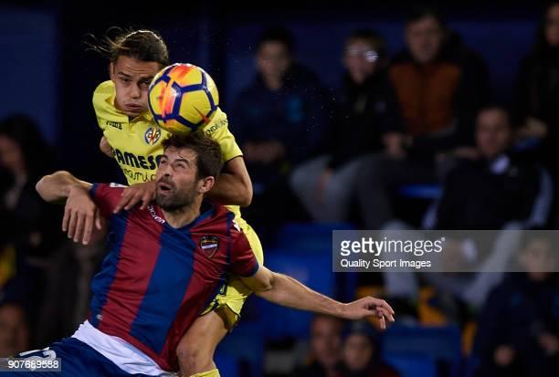 Enes Unal of Villarreal competes for the ball with Koke of Levante during the La Liga match between Villarreal and Levante at Estadio de la Ceramica...