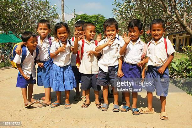 CONTENT] enfants rieurs à la sortie de l'école dans la banlieue de Phnom Penh sur l'ile de ko dach sur le mékong au cambodge kids look very happy...