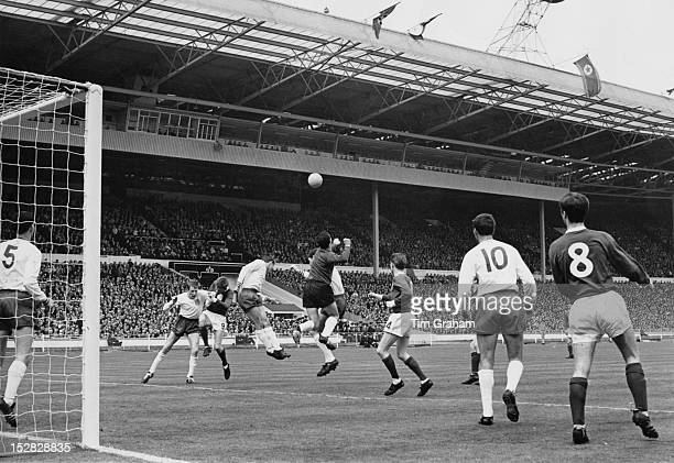 Enfield goalkeeper I Wolstenholme punches clear during an attack by Skelmersdale during the final of the FA Amateur Cup at Wembley Stadium London...