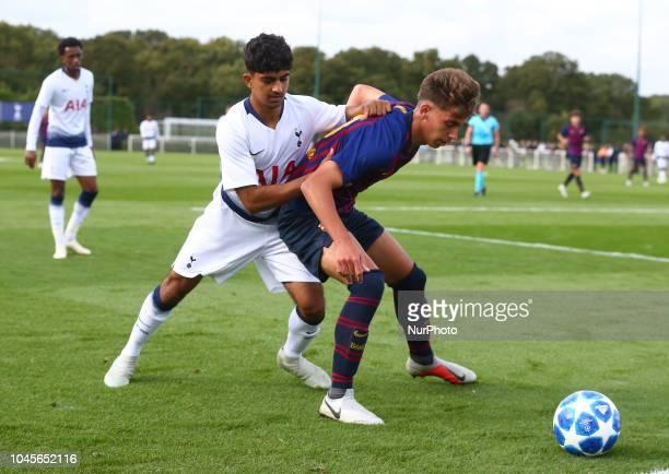 Enfield UK 03 October 2018 LR Dilan Markanday of Tottenham Hotspur and Jose Martinez Marsa of FC Barcelona during UEFA Youth League match between...