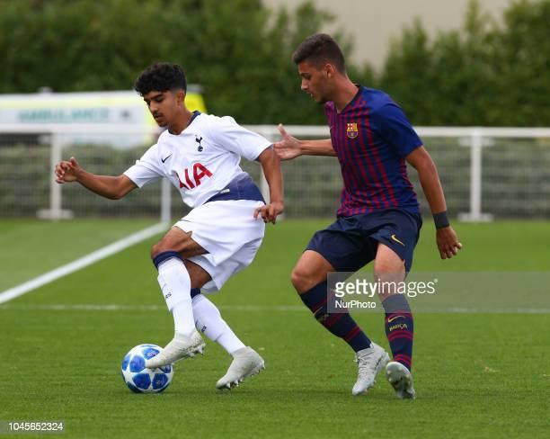 Enfield UK 03 October 2018 LR Dilan Markanday of Tottenham Hotspur and Nils Mortimer of FC Barcelona during UEFA Youth League match between Tottenham...