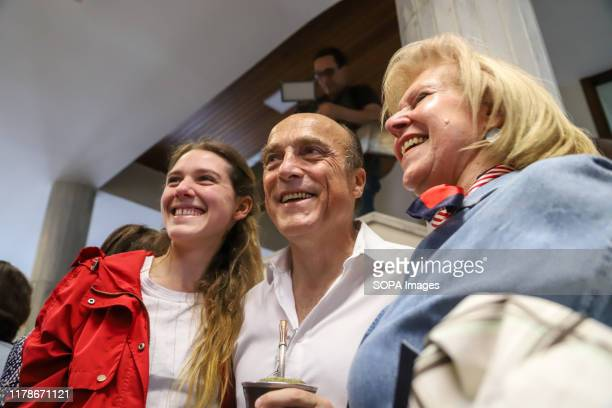 Eng. Daniel Martinez, candidate for the Frente Amplio party poses for a photo with his supporters. The National party and the Frente Amplio party...