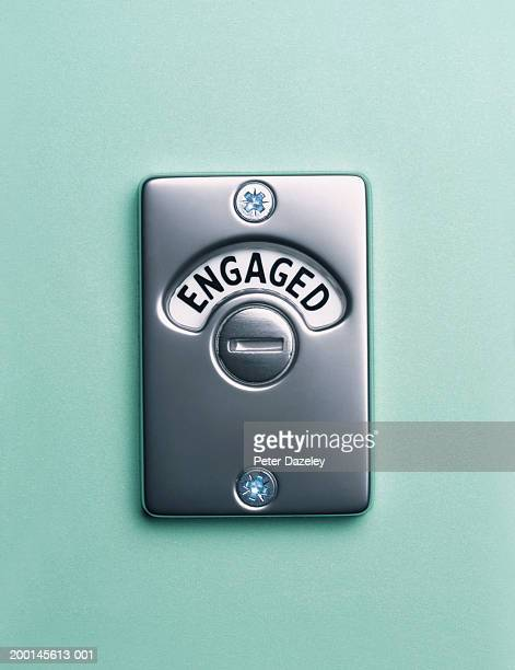 'engaged' lock, close up - public toilet stock pictures, royalty-free photos & images