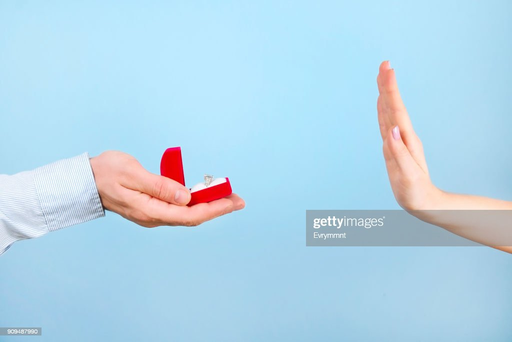 Engagement / marriage / wedding proposal refusing / rejection / not accepting scene. Close up of man handing the expensive gold platinum diamond ring to his bride. : Stock Photo
