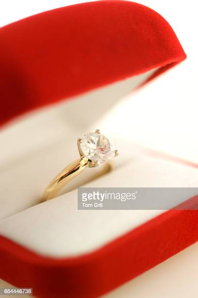 engagement ring in red box - engagement ring box stock photos and pictures