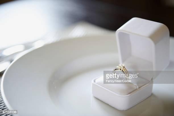 engagement ring on plate - 宝石箱 ストックフォトと画像