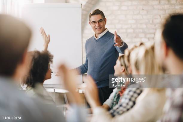 engaging business presentation in the office! - faq stock pictures, royalty-free photos & images