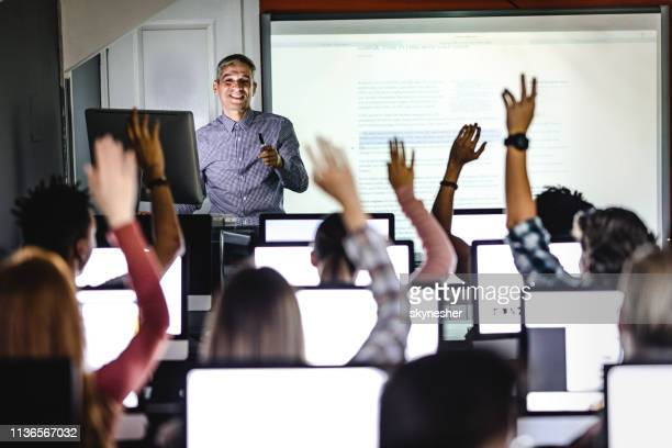 engaging class at computer lab! - academy stock pictures, royalty-free photos & images