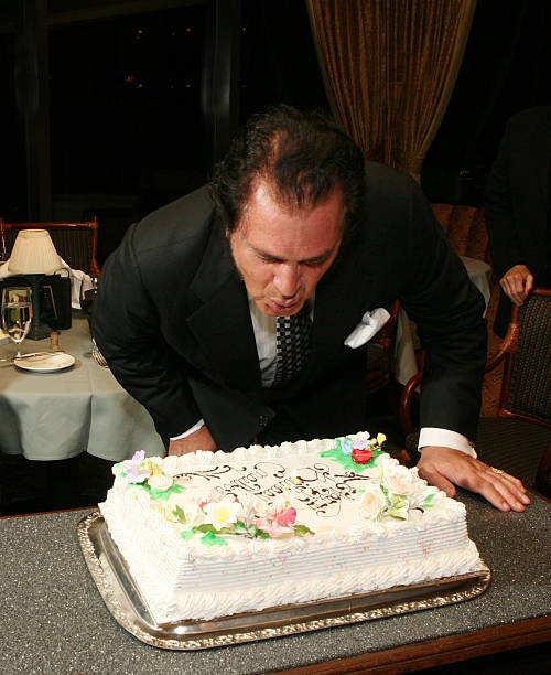 Engelbert Humperdinck Blows Out The Candle Of His Birthday Cake To Celebrate 70th