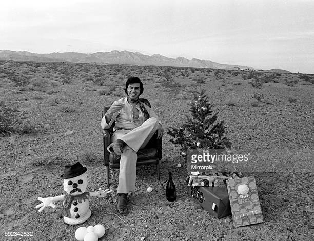 Engelbert Humperdinck sitting in a chair with a Christmas tree and toy snowman in the Nevada Desert The middle of the Nevada Desert may not be...