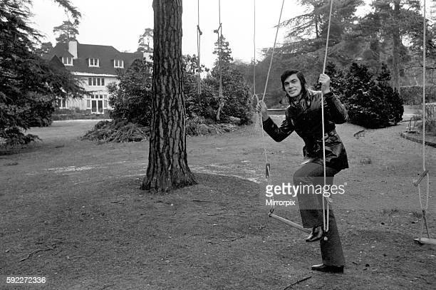 Engelbert Humperdinck's new home in St Gerorge's Hill Weybridg Playing on swings at bottom of garden December 1969 Z12240