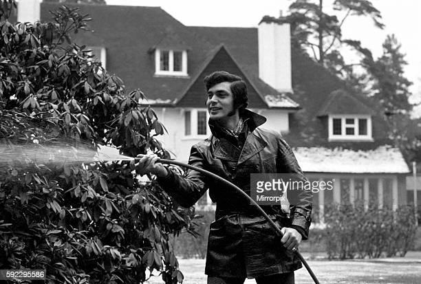 Engelbert Humperdinck's new home in St Gerorge's Hill Weybridg Engelbert watering the plants in his garden December 1969 Z12240017