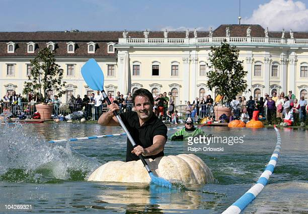 Engelbert Lanz paddles in a hollowed pumpkin across a lake at Ludwigsburg Castle on September 19 2010 in Ludwigsburg Germany During the annual...