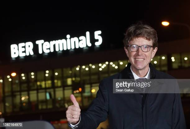 Engelbert Luetke Daldrup, head of the Berlin airport authority Flughafen Berlin Brandenburg GmbH, gestures with a thumbs up after inaugurating former...