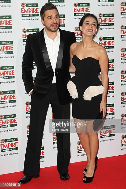 Engin Altan Duzyatan and Ozge Ozpirincci arrives at the Jameson Empire Awards at The Grosvenor House Hotel on March 27 2011 in London England