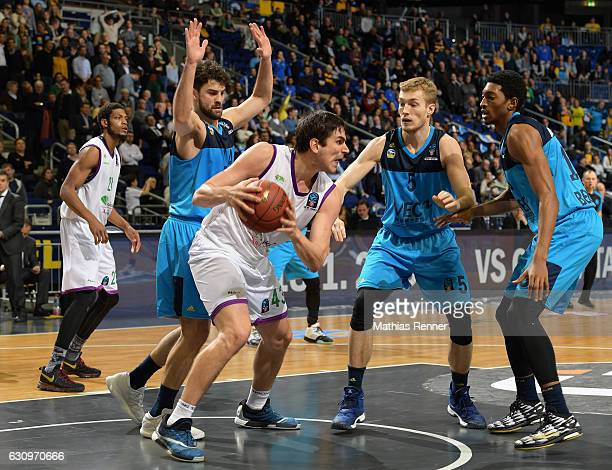 Engin Atsuer of Alba Berlin Carlos Suarez of Unicaja CB Malaga Niels Giffey and Malcolm Miller of Alba Berlin during the game between Alba Berlin and...