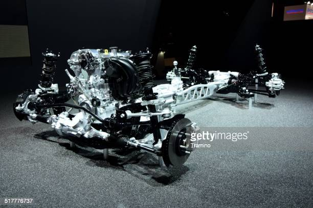 Engine and car chassis on the motor show