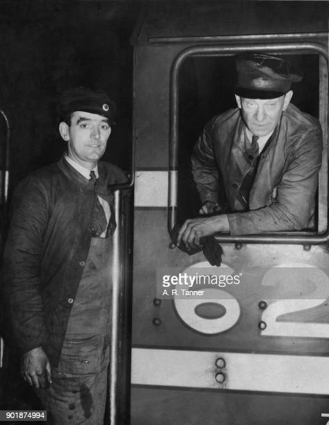 Engine driver F C Bishop and fireman J McKinnon Carswell at Euston Station in London having arrived on the 'Royal Scot' 29th December 1938 Bishop...