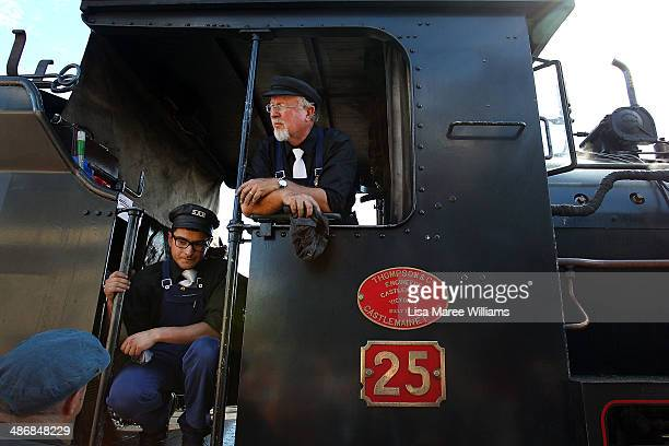 Engine drivers of the Pichi Richi steam train relax after taking passengers of The Ghan on a day trip through the Flinders Ranges on April 26 2014 in...
