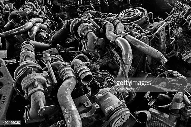 Engine parts from high polluting vehicles taken off the road by authorities are seen piled up at an auto scrapyard on September 25 2015 in Zhejiang...