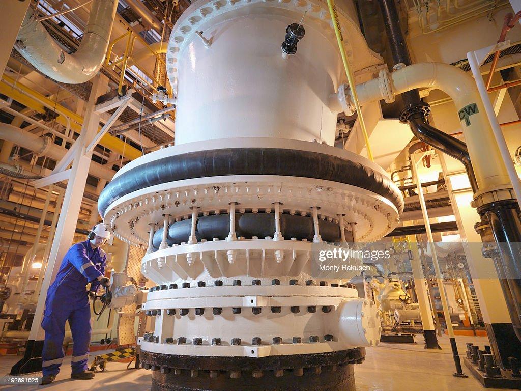 Engineer adjusting seawater valve in power : Stock Photo