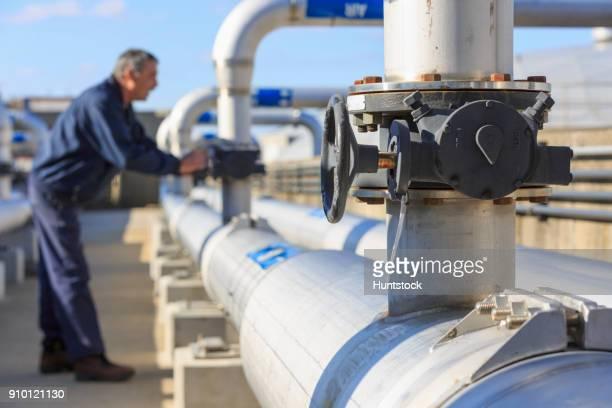 Engineer adjusting water flow control valve