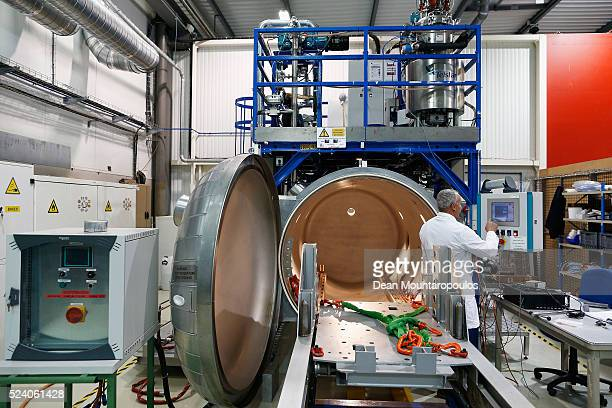 Engineer Ahmed Benfik inspects the vacuum chamber used for molding in New Technologies for Future Magnets Building 927 at The European Organization...