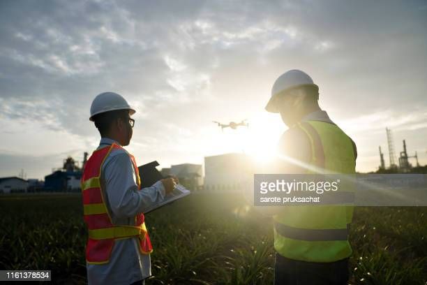 engineer and architect working at oil-refinery site with drone . - drohnenperspektive stock-fotos und bilder