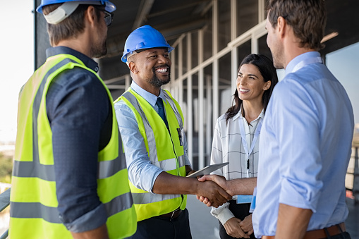 Engineer and businessman handshake at construction site 1189913170