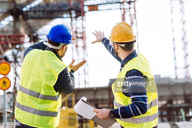 Engineer and construction site manager dealing with next construction phase