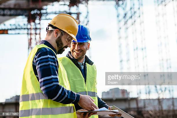 engineer and construction site manager dealing with next construction phase - bridge built structure stock pictures, royalty-free photos & images