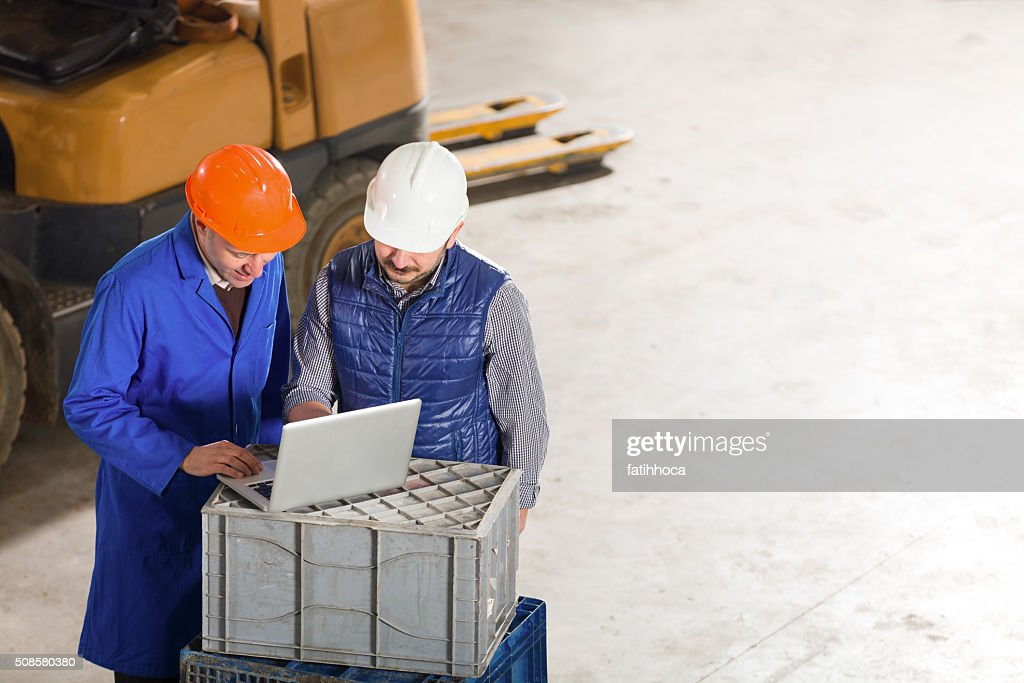 Engineer and Foreman : Stock Photo