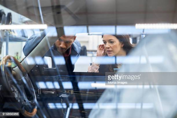 engineer and manager analyzing car in industry - vintage auto repair stock pictures, royalty-free photos & images