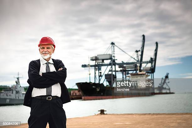 engineer at commercial dock - koper stock photos and pictures