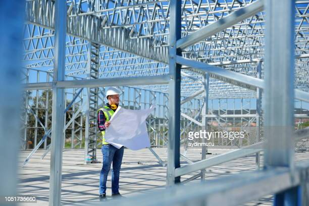 engineer at construction site - design stock pictures, royalty-free photos & images