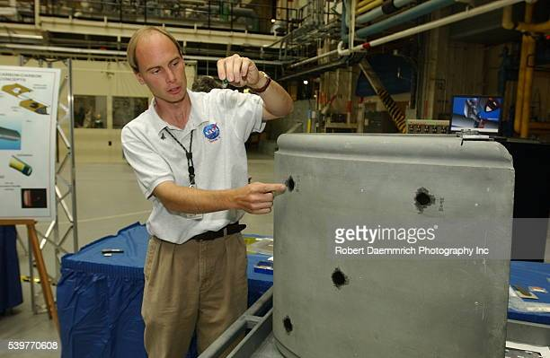 NASA engineer Brad Filer explains how repairs will be done to the RCC or leading edge of the wings where the heat of reentry to the earth's...